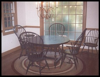 Round Tavern Table with Pinch Bow Sack Back Chairs
